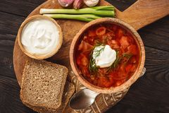 Borscht - traditional russian and ukrainian beetroot soup on wooden background. Borscht - traditional russian and ukrainian beetroot soup on wooden background royalty free stock images