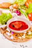 Borscht with vegetables and meat in pink plate. Ukrainian cuisine stock photography