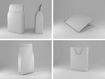 Borse d'imballaggio e bianco della cartella Fotografia Stock