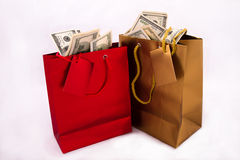 Borse del regalo con i dollari Immagini Stock
