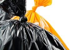 Borse di immondizia arancio e nere Immagine Stock Libera da Diritti