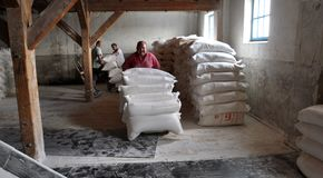 Borse di usura dei lavoratori di farina Fotografia Stock