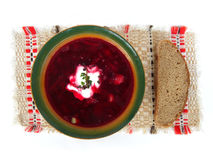 Borshch bowl with bread. Bowl of beet root soup, known as borshch, with piece of bread Stock Images