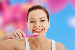 borsta henne tandkvinna Royaltyfri Bild