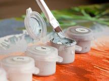Borsta och måla behållare för att måla vid nummer Royaltyfria Foton