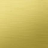borstad textur för guldmetallstål Fotografering för Bildbyråer