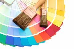 Borstar med en handbok för färgpalett Fotografering för Bildbyråer