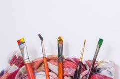 Borstar och färger Arkivbild