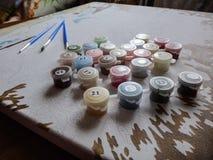 Borstar och målar Arkivbild