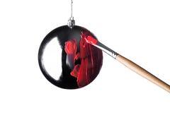 Borste för julleksakmålarfärg Arkivfoto