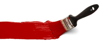 Borste med röd målarfärg Arkivfoto