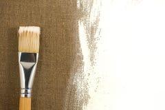 Borstel en canvas stock afbeeldingen