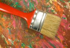 borstel en canvas met verven stock afbeelding