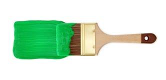 Borstel met groene verf stock foto