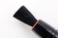 Borstel voor het schoonmaken van lenzenclose-up Stock Afbeeldingen