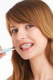 Borstelende tanden Stock Foto's