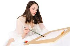 borsten tecknar kvinnabarn royaltyfria bilder