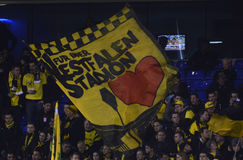 Borussia Dortmund ultras flag. Borussia's ultras wave a flag priro to the UEFA Europa League round of 16 game between Tottenham Hotspur and Borussia Dortmund on stock images
