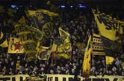 Borussia Dortmund ultras flags. Borussia's ultras waving flags prior to the UEFA Europa League round of 16 game between Tottenham Hotspur and Borussia Dortmund stock images