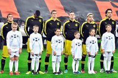 Borussia team and children on the field Royalty Free Stock Images