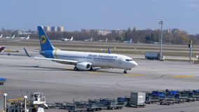 Arriving Passenger aircraft moves on the runway at the airport. Boryspil, Ukraine, April 3, 2019: Arriving passenger aircraft moves on the runway at the airport stock video footage