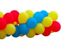 Bos van rode, blauwe en gele die ballons over wit worden geïsoleerd Royalty-vrije Stock Afbeelding