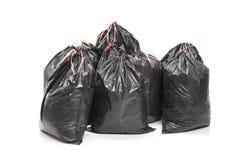 Bos van vuilniszakken op witte achtergrond worden geïsoleerd die Stock Afbeelding