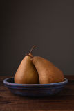 Bosc Pears on Plae Royalty Free Stock Photography