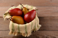 Bosc and Red Pears in Basket Stock Images