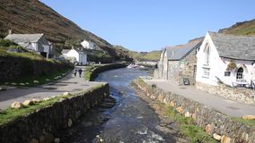 Boscastle Cornwall England UK river flowing towards the harbour stock footage