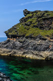 Boscastle harbour entrance. Rock formation at entrance to Boscastle harbour, in Cornwall, southwest,England,UK Royalty Free Stock Photo