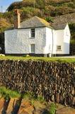 Boscastle village cottage, Cornwall, England, UK. Typical Cornish village cottage and stone wall. Boscastle in North Cornwall, England, Britain Stock Photo