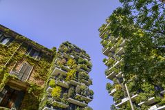 Bosco Verticale is a pair of two upscale residential towers in Milan`s Porta Nuova district consisting of hundreds of. Milan, Italy - April 25, 2018: Bosco Stock Images