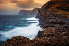Bosdalafossur waterfall sunset. Bosdalafossur waterfall on Vagar island coastline in sunset, Faroe Islands Royalty Free Stock Images