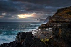 Bosdalafossur waterfall coastline. Bosdalafossur waterfall on Vagar island coastline in sunset, Faroe Islands stock images