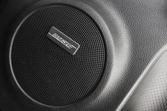 Bose car audio component, round side speaker Royalty Free Stock Image