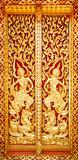 Bose columns carved wooden doors with golden angels treatment. Stock Photos
