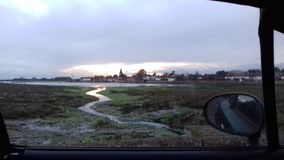 Bosham harbour out the window. Of a car stock photo