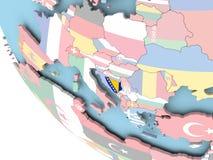 Bosnia with flag on globe Stock Image