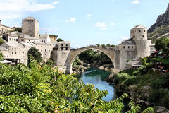 Bosnia and Hercegovina: Mostar Bridge. Famous old white bridge in Mostar crossing the Neretva river splitting the city in two Royalty Free Stock Photography