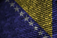Bosnia and Herzegovina flag is depicted on the screen with the program code. The concept of modern technology and site. Development stock photo
