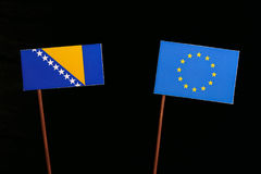 Bosnia and Herzegovina flag with European Union EU flag isolated on black. Background Royalty Free Stock Photography