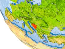 Bosnia and Herzegovina on globe. Map of Bosnia and Herzegovina in red on globe with real planet surface, embossed countries with visible country borders and Royalty Free Stock Image