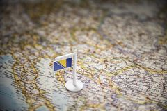 Bosnia and Herzegovina marked with a flag on the map.  stock photography