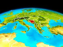 Bosnia and Herzegovina in red. Satellite view of Bosnia and Herzegovina highlighted in red on planet Earth with borderlines. 3D illustration. Elements of this Stock Image