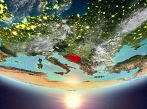 Bosnia and Herzegovina with sun. Bosnia and Herzegovina during sunrise highlighted in red on planet Earth with clouds. 3D illustration. Elements of this image Stock Photo