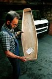 BOSNIAN CIVIL WAR. SARAJEVO, BOSNIA, 12 MAY 1993 - A Bosnian Moslem funeral director holds up a child's coffin made from the wooden seats of the 1984 Winter Stock Image