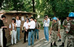 BOSNIAN CIVIL WAR. SARAJEVO, BOSNIA, 12 MAY 1993 --- The Sarajevo press corps, from left: Paul Marchon, Christian Amanpour, Kurt Schork, John Burns, Luc Delahaye Royalty Free Stock Photography