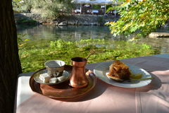 Bosnian coffee. And baklava on the river bank royalty free stock images