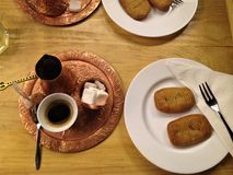 Bosnian coffee and hurmasice desert served traditionally stock image
